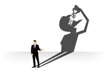 Concettuale dell'uomo d'affari gettare un'ombra ha modellato come il diavolo quel dollaro del cibo Fotografia Stock