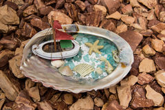 Conch shell with boat Stock Photos