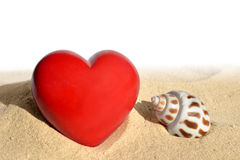 Conch shell with heart in sand Royalty Free Stock Photos