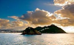 Concha beach from Donosti. Concha beach, Santa Clara island, Igueldo mountain, and sea and sky Royalty Free Stock Image