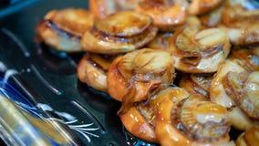 Conchas de peregrino deliciosas con la salsa de Teriyaki fotos de archivo libres de regalías
