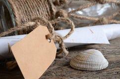 Conchas do mar e frasco de vidro Foto de Stock Royalty Free