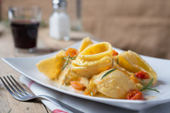 Conchiglie with pumpkin's cream. Conchiglie con crema di zucca Stock Photos