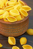 Conchiglioni italian pasta in wood bowl Royalty Free Stock Photography