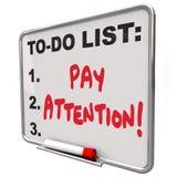 Conciencia consciente atenta del tablero de mensajes de la atención de la paga Imagen de archivo libre de regalías