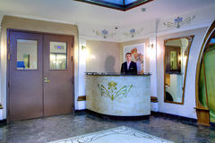 Concierge at the entrance to elite apartment building. Royalty Free Stock Photography