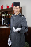 Concierge greeting guests in hotel Royalty Free Stock Images