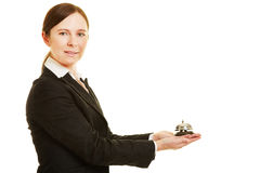 Concierge holding hotel bell Stock Image