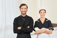 Concierge and maid in hotel room Stock Images