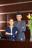 Concierge and receptionist at hotel reception Stock Photo