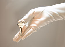 Concierge service. White gloves holds a key, concierge service advertisement Stock Images