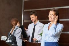 Concierge serving hotel guests stock photos