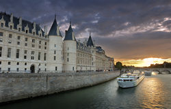 Conciergerie. The Pont Neuf (New Bridge), bridge over the Seine River and the Conciergerie, a former royal palace and prison in Paris, France stock image