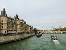 Conciergerie on the banks of the Seine. A view of the Conciergerie on the Ile de la Cite on the banks of the Seine in Paris royalty free stock photos