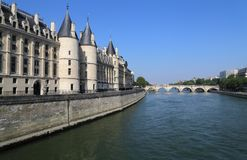 Conciergerie building in Paris, France. Historical Conciergerie building and bridge across the Seine in Paris, France royalty free stock images