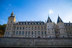 He Conciergerie Castle from the River Seine in Paris, France stock photography