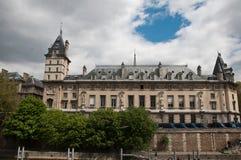 Conciergerie castle with Seine river in Paris Stock Photography