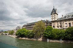 Conciergerie castle with Seine river in Paris Royalty Free Stock Photo