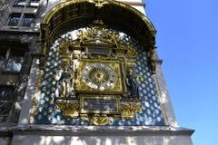 The Conciergerie, Paris, France. Clock closeup with sun light and shadows. The oldest public clock in Paris. stock photos