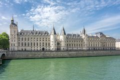 Conciergerie palace at Seine river in Paris, France stock photography