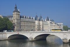 Conciergerie and Pont au Change. Paris. Cite island view with La Conciergerie and Pont au Change, over the Seine river. Paris, France royalty free stock photos