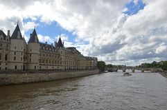 The Conciergerie and the River Seine, Paris France. The Conciergerie is a building in Paris, France, located on the west of the Île de la Cité, formerly a royalty free stock image