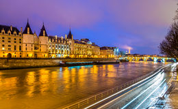 The Conciergerie and the Seine river in Paris Stock Images