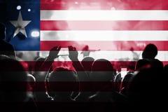 Concierto de la música en directo con la mezcla de la bandera de Liberia en fans Fotografía de archivo