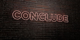CONCLUDE -Realistic Neon Sign on Brick Wall background - 3D rendered royalty free stock image Royalty Free Stock Photo