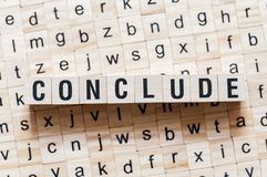 Conclude word concept on cubes stock photography