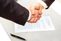 The conclusion of the contact. Closeup of a business hand shake between two colleagues Stock Photography