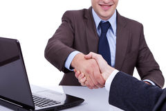 Conclusion of job interview. Two young man shaking hands Royalty Free Stock Image