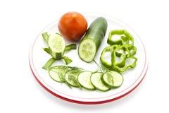 Concombre frais avec le poivron et la tomate Photos libres de droits