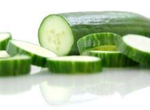 Concombre sur le blanc Photos stock