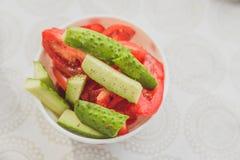 Concombres et tomates frais Image stock