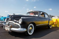 1949 Buick Super. CONCORD, NC - April 8, 2017:  An unrestored 1949 Buick automobile on display at the Pennzoil AutoFair classic car show held at Charlotte Motor Royalty Free Stock Image