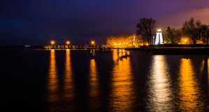 Concord Point Lighthouse and a pier at night in Havre de Grace Stock Photography