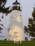 Concord Point Lighthouse in the Shadows of the Sunset. Erected at the mouth of the Susquehanna River in 1827, this lighthouse is located in Havre de Grace Royalty Free Stock Photography