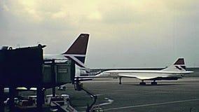 Concorde at Miami airport. Miami, Florida, United States - Circa 1979:Airplane Concorde taking off, Miami international airport in 70`s with buildings. United stock video