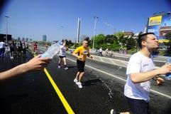 Concorrentes corridos durante a raça de maratona Foto de Stock Royalty Free