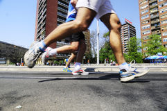 Concorrentes corridos durante a raça de maratona Imagem de Stock