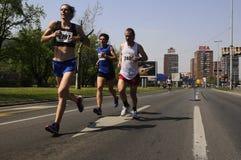 Concorrentes corridos durante a raça de maratona Fotos de Stock Royalty Free