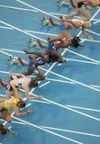 Concorrentes de mulheres de 100m imagem de stock royalty free