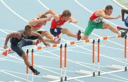 Concorrentes de obstáculos de 110 medidores Fotografia de Stock Royalty Free