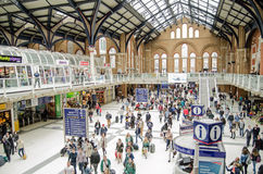 Concourse, Liverpool Street Station, London. LONDON, ENGLAND - APRIL 12, 2014: Crowds of passengers on the concourse of Liverpool Street Station in the City of royalty free stock image