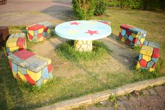 Concreate made table and benches in a childrens park. Concreate made bench and table in park royalty free stock image