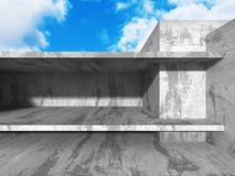 Concrete abstract architecture on cloudy sky background Stock Image