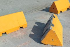 Concrete anti-terrorism barriers on a sidewalk. royalty free stock photography