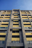 Concrete Apartment Block with yellow facade panels/paint - Architectural background/Texture Stock Photography