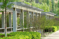 Concrete arbour. The concrete arbour in park trees Royalty Free Stock Photography